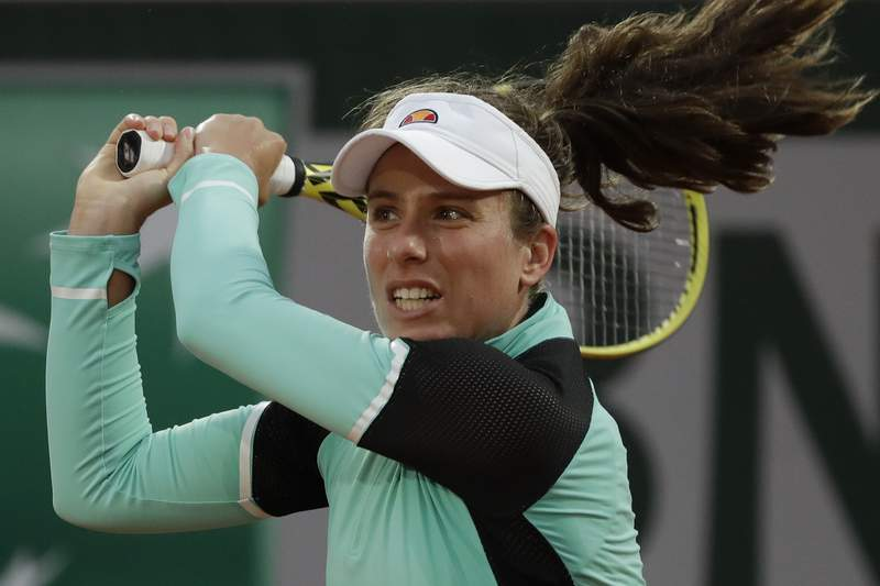 FILE - Britain's Johanna Konta plays a shot against Cori Gauff in the first round match of the French Open tennis tournament at Roland Garros stadium in Paris, France, in this Sunday, Sept. 27, 2020, file photo. Three-time Grand Slam semifinalist Johanna Konta returned to competition Tuesday, Aug. 10, 2021, after a two-month absence during which she caught COVID-19 and dealt with what she called a massive range of symptoms. Definitely the worst illness I've experienced for a very long time, Konta said in an interview with The Associated Press.(AP Photo/Alessandra Tarantino, File)