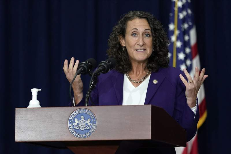 FILE - In this Thursday, Nov. 5, 2020, file photo, Pennsylvania Secretary of State Kathy Boockvar speaks during a news conference about counting votes from Tuesday's election, in Harrisburg, Pa. After navigating the sea of challenges in 2020, Boockvar is leaving her job in Democratic Gov. Tom Wolf's cabinet under a cloud that has nothing to do with last year's election. (AP Photo/Julio Cortez, File)