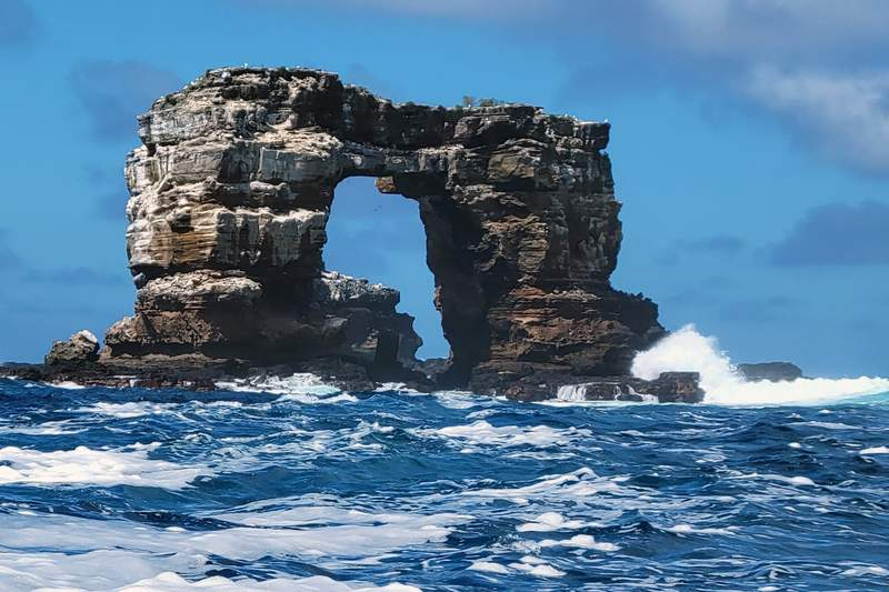 This photo distributed by Galapagos National Park shows Darwin's Arch off the Galapagos Islands, Ecuador, Sunday, May 16, 2021. Ecuadors Environment Ministry reported the collapse of the top of the arch on its Facebook page on Monday, May 17, and blame natural erosion of the stone. (Galapagos National Park via AP)