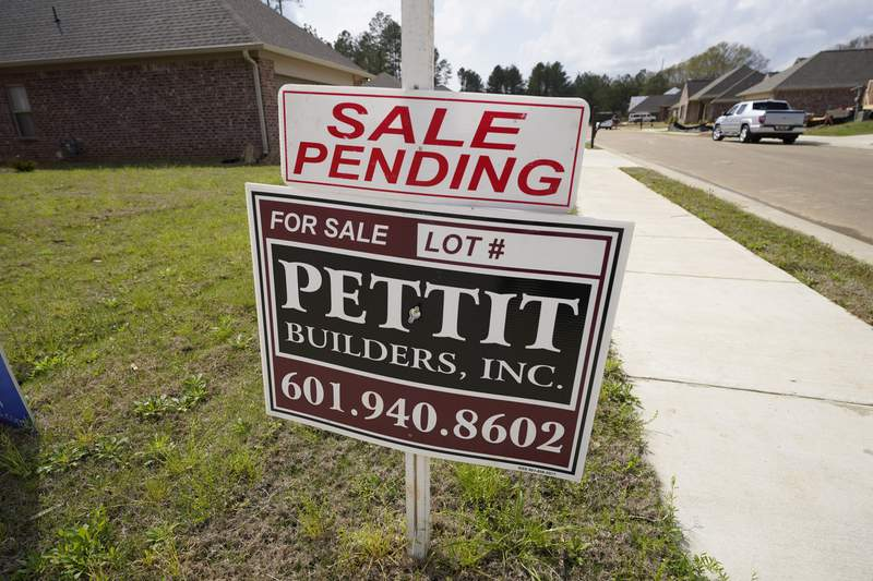 """A """"sale pending"""" sign stands along side a housing lot in Madison County, Miss., Tuesday, March 16, 2021. U.S. long-term mortgage rates continued to edge higher this week as the benchmark 30-year loan stayed above the 3% mark. Rates remain near historic lows, however.  (AP Photo/Rogelio V. Solis)"""