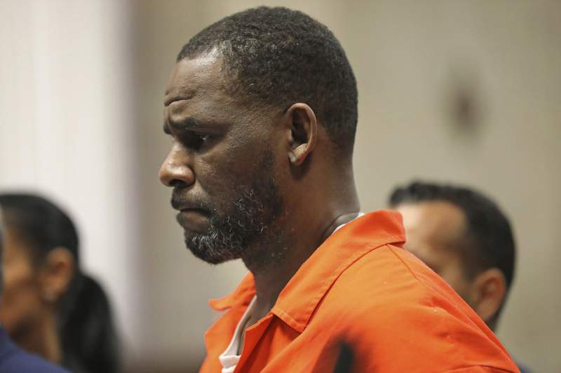 FILE - In this Sept. 17, 2019, file photo, R. Kelly appears during a hearing at the Leighton Criminal Courthouse in Chicago. Attorneys for R. Kelly want to question a convicted member of the Latin Kings gang who says he beat up the jailed R&B singer in a Chicago cell. Kelly's lawyers filed a motion Friday, Aug. 4, 2020 in federal court to question Jeremiah Farmer under oath, theChicago Tribunereported. (Antonio Perez/Chicago Tribune via AP, Pool, File)