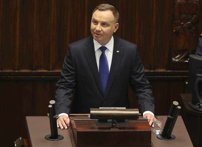 Poland's President Andrzej Duda speaks to parliament members after he had been sworn in for a second term, at the parliament, in Warsaw, Poland, on Thursday, August 6, 2020. Many of Poland's former leaders abstained from the ceremony to show disapproval for his first term policies.(AP Photo/Czarek Sokolowski)