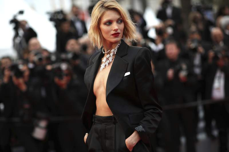 FILE - In this Friday, May 17, 2019 file photo, model Anja Rubik poses for photographers at the 72nd international film festival, Cannes, southern France. A Nobel laureate, a Netflix star and a fashion model are among the board members who helped launch an initiative Tuesday, June 1, 2021 to raise money for LGBT rights groups in Poland, where gay men, lesbians, and bisexual and transgender people face a backlash from the country's conservative government and Catholic Church. We can't count on aid from within the country, said model Anja Rubik, who is one of the board members. (AP Photo/Petros Giannakouris, file)