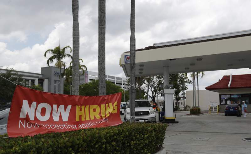 This file photo shows a now hiring sign in North Miami Beach. Jobless claims are dropping month over month, but there is concern about potential future shutdowns as COVID-19 numbers rise, particularly in South Florida.