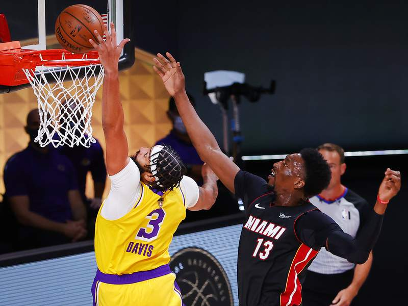 Anthony Davis and Bam Adebayo fight for a rebound during the first quarter in Game One of the 2020 NBA Finals at AdventHealth Arena at the ESPN Wide World Of Sports Complex on September 30, 2020 in Lake Buena Vista, Florida.