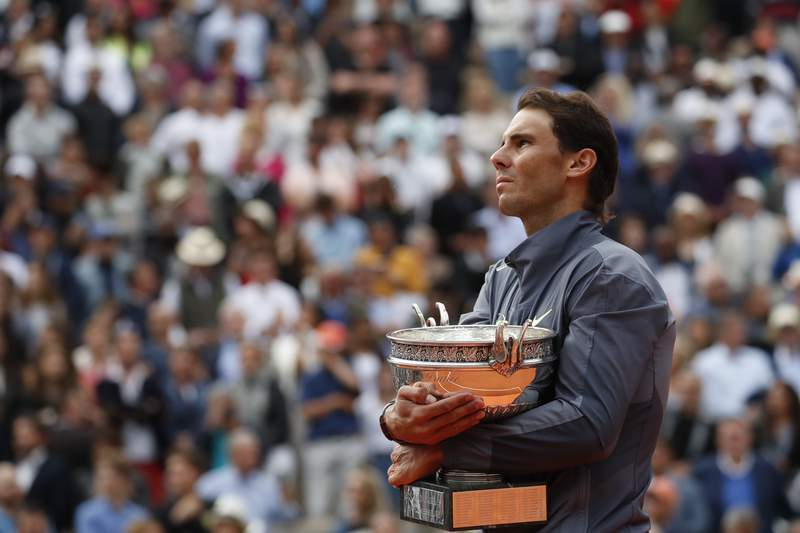 FILE - In this June 9, 2019, file photo, Spain's Rafael Nadal celebrates his record 12th French Open tennis tournament title after winning the men's final against Austria's Dominic Thiem at Roland Garros stadium in Paris. If not for the coronavirus pandemic, the second week of the French Open this week would have had fourth-round matches, quarterfinals, semifinals and the final for men and women. Nadal could have been trying to add to his 12 trophies at Roland Garros. (AP Photo/Christophe Ena, File)