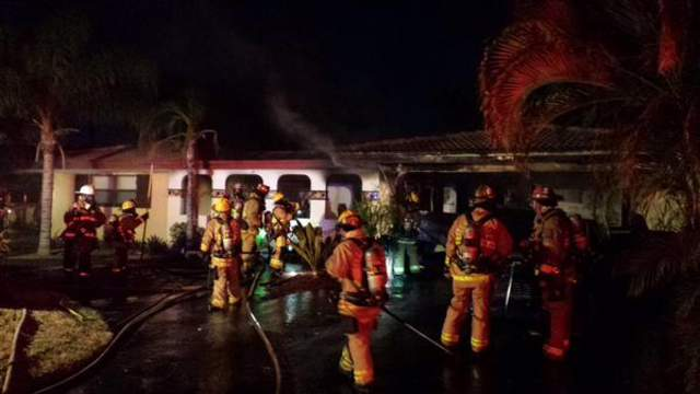 Firefighters battle a house fire in Wilton Manors.