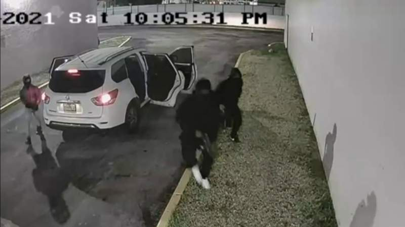 Video shows shooters jump out of white Nissan Pathfinder