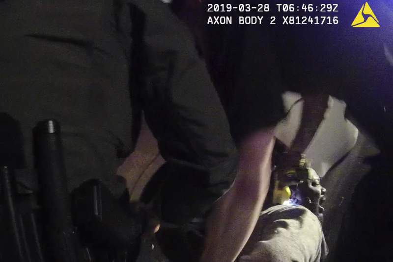 In this image made from a March 28, 2019, body-worn camera video provided by the Austin Police Department in Texas, Williamson County deputies hold down Javier Ambler as one of them uses a Taser on Amblers back during his arrest in Austin, Texas. The black man died in custody in 2019 after sheriff's deputies repeatedly used stun guns on him, despite his pleas that he was sick and couldn't breathe, according a report published Monday, June 8, 2020, by the Austin American-Statesman and KVUE-TV. The video was made on the camera worn by an Austin police officer who also showed up at the scene as Williamson County deputies were making the arrest. (Austin Police Department via AP)