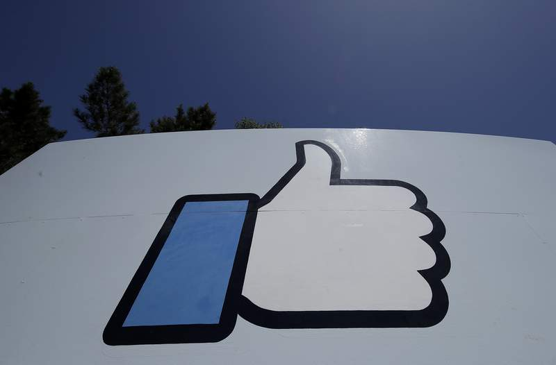 "FILE - This April 25, 2019, file photo shows the thumbs-up ""Like"" logo on a sign at Facebook headquarters in Menlo Park, Calif. Facebook, following in Googles footsteps, says it plans to invest $1 billion to support the news industry over the next three years. The social networking giant, which has been tussling with Australia over a law that would make social platforms pay news organizations, said it has invested $600 million since 2018 for news. (AP Photo/Jeff Chiu, File)"