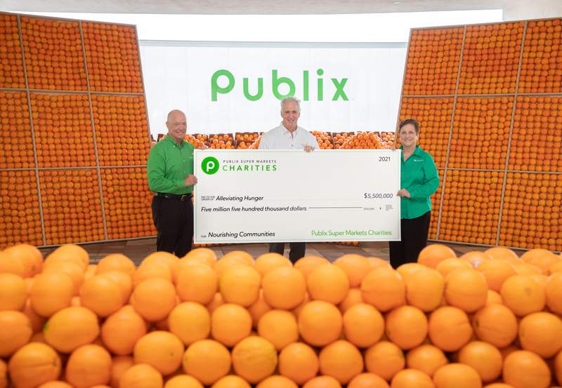 From left: Todd Jones, Publix CEO; Thomas Mantz, Feeding America; and Kelly Williams-Puccio, Director of Publix Charities.