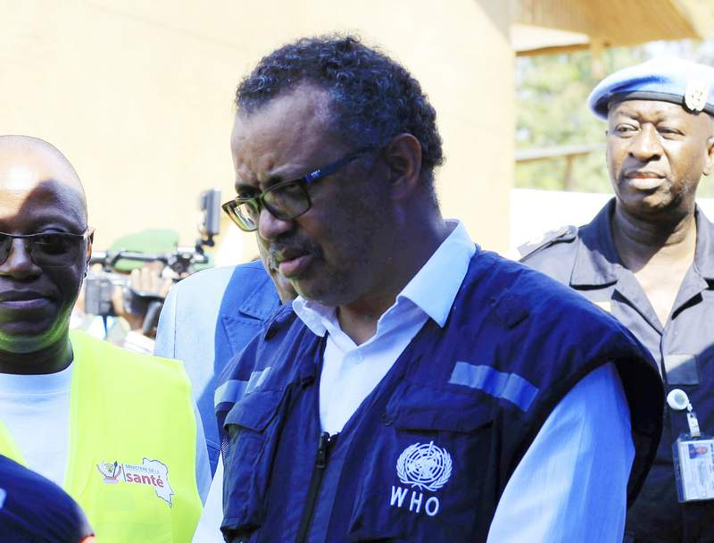 FILE - In this file photo dated Friday, Aug. 10, 2018, Dr. Tedros Adhanom Ghebreyesus, WHO Director General, speaks to a health official at a newly established Ebola response center in Beni, Democratic Republic of Congo. British, European and American diplomats and donors have voiced serious concerns about how the World Health Organization handled sex abuse allegations involving their own staff during an outbreak of Ebola in Congo. (AP Photo/Al-hadji Kudra Maliro, FILE)