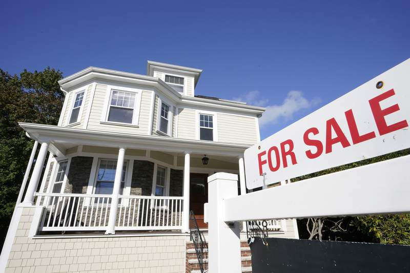 FILE - A for sale sign stands in front of a house, Tuesday, Oct. 6, 2020, in Westwood, Mass. American homeowners were given an expanded opportunity to hit pause on their mortgage payments because of the financial ravages of the pandemic, but that relief is slowly coming to an end.  (AP Photo/Steven Senne, File)