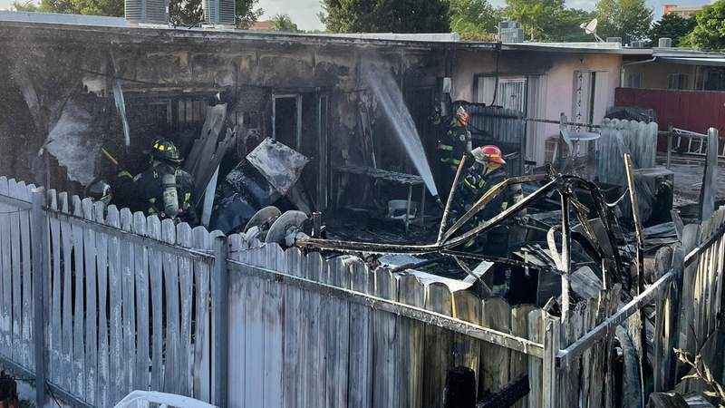 Firefighters extinguish townhouse fire on Thursday in Hialeah.