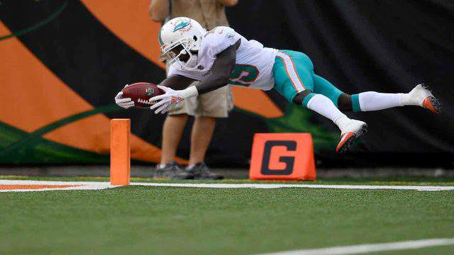Miami's Jakeem Grant dives for a touchdown after returning a punt 70 yards during the second quarter against the Cincinnati Bengals, Oct. 7, 2018, in Cincinnati.
