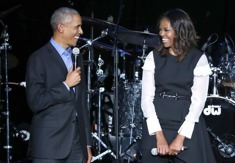 FILE - Former President Barack Obama, left, and former first lady Michelle Obama appear on stage during a community concert at the Obama Foundation Summit on Nov. 1, 2017, in Chicago. The first guest of Michelle Obamas new podcast will have a familiar presidential face: Barack Obama. The former president will appear on The Michelle Obama Podcast on Spotify, the Obamas Higher Ground and the streaming service announced Friday, July 24, 2020 . The podcast will debut on July 29. (AP Photo/Charles Rex Arbogast, file)