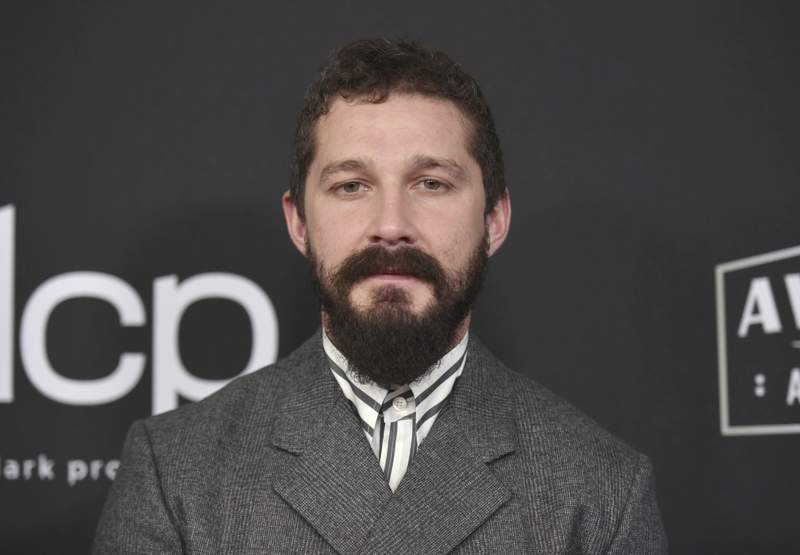 FILE - In this Nov. 3, 2019, file photo, Shia LaBeouf arrives at the 23rd annual Hollywood Film Awards at the Beverly Hilton Hotel in Beverly Hills, Calif. LaBeouf has been charged on Sept. 24, 2020, with misdemeanor battery and petty theft. Prosecutors allege that the 34-year-old actor fought with a man named Tyler Murphy and took his hat on June 12, according to a criminal complaint obtained by The Associated Press on Thursday, Oct. 1, from the Los Angeles city attorney. (Photo by Richard Shotwell/Invision/AP, File)