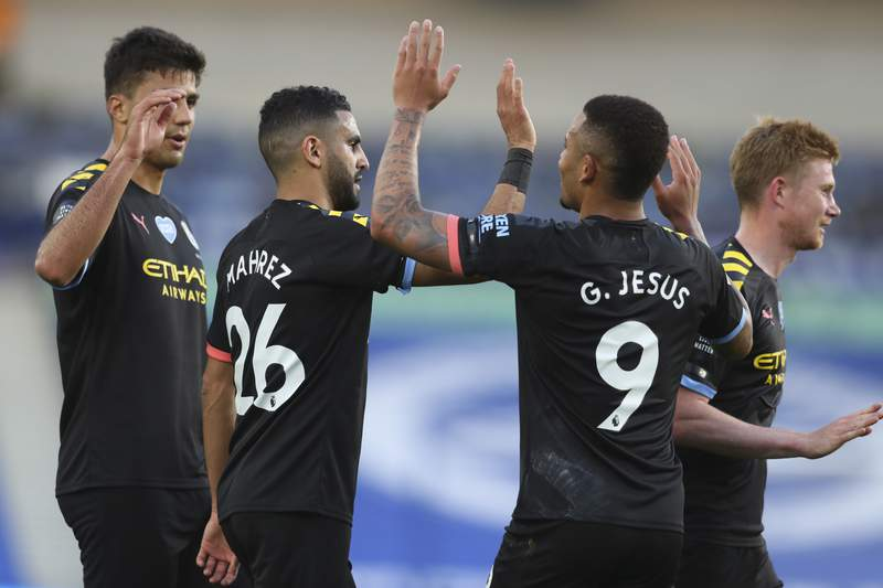 Manchester City's Gabriel Jesus (9) celebrates after scoring his side's second goal during the English Premier League soccer match between Brighton and Manchester City at the Falmer stadium in Brighton, England, Saturday, July 11, 2020. (Cath Ivill/Pool via AP)