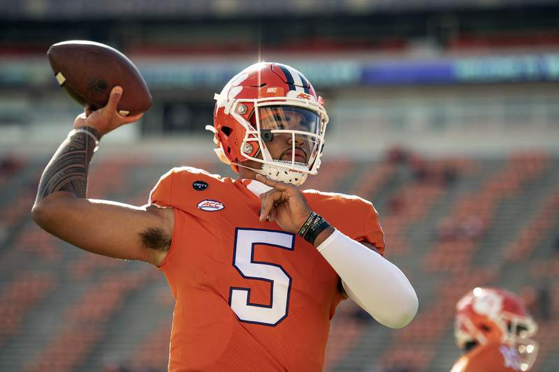 FILE - In this Oct. 31, 2020, file photo, Clemson quarterback D.J. Uiagalelei (5) warms up before an NCAA college football game against Boston College in Clemson, S.C. Uiagalelei finally has the national spotlight to himself. Uiagalelei and the No. 3 Tigers meet the fifth-ranked Bulldogs Saturday night in the Dukes Mayo Classic, a neutral site game in Charlotte, N.C. (Josh Morgan/Pool Photo via AP, File)