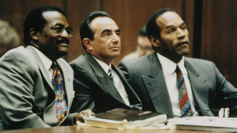 (from right) Johnnie Cochran, Robert Shapiro and O.J. Simpson. Photo by Ted Soqui/Sygma