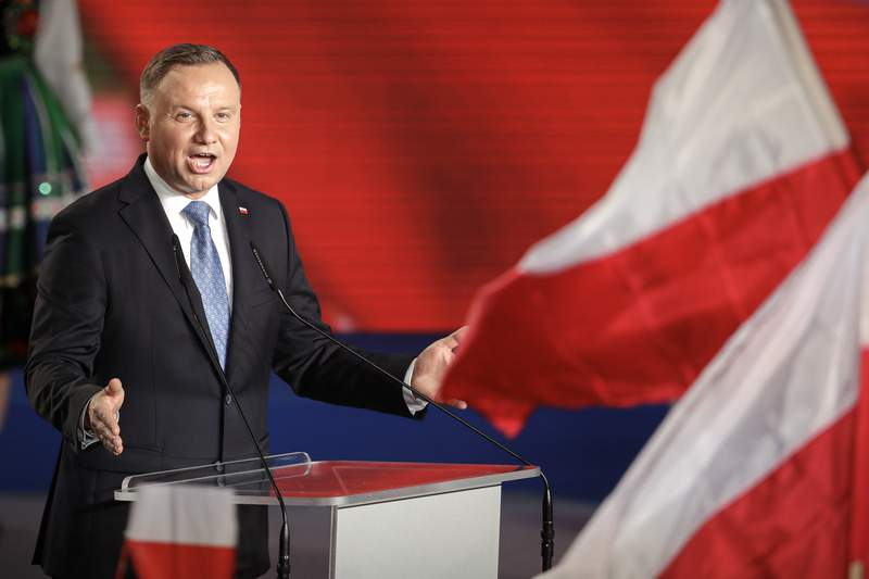 FILE - In this Sunday, June 28, 2020 file photo, President Andrzej Duda addressees supporters after voting ended in the presidential election in Lowicz, Poland. A Polish writer is being threatened with up to three years of imprisonment for calling the nation's president a moron on social media. The writer, Jakub Zulczyk,  had criticized the manner in which Polish President Andrzej Duda  a close ally of former President Donald Trump  had reacted to the electoral victory of President Joe Biden last year. (AP Photo/Petr David Josek, File)