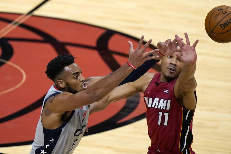 Washington Wizards forward Troy Brown Jr., left, loses control of the ball as Miami Heat guard Avery Bradley (11) defends during the first half of an NBA basketball game Wednesday, Feb. 3, 2021, in Miami. (AP Photo/Lynne Sladky)