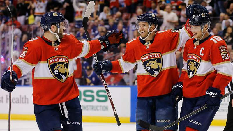Jonathan Huberdeau celebrates with teammates after becoming the Florida Panthers frachise leader in points on January 12, 2020.