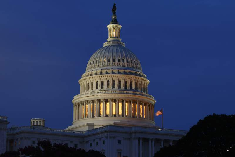 FILE - This July 16, 2019, file photo shows the Capitol Dome in Washington.  The U.S. government's budget deficit hit $735.7 billion through the first four months of the budget year, an all-time high for the period, as a pandemic-induced recession cut into tax revenues while spending on COVID relief measures sent outlays soaring. The Treasury Department reported Wednesday, Feb. 10, 2021,  that the deficit so far for the budget year that began Oct. 1 is 89% higher than the $389.2 billion deficit run up in the same period a year ago.  (AP Photo/Carolyn Kaster, File)