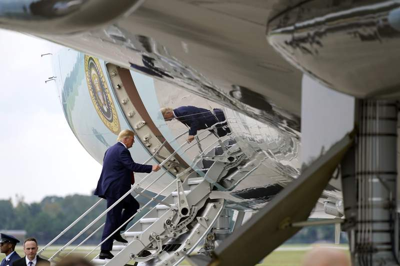 President Donald Trump boards Air Force One at Wilmington International Airport, Wednesday, Sept. 2, 2020, in Wilmington, N.C. (AP Photo/Evan Vucci)
