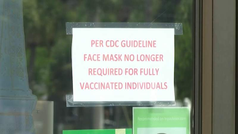 Mask required signs are coming down at businesses across Florida after the CDC's new rules stating those who are vaccinated don't have to wear masks.