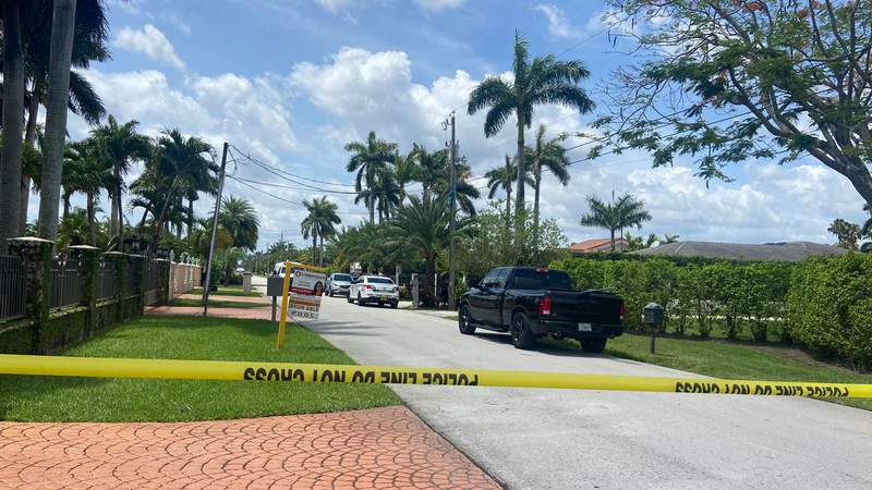 Officers respond to an armed home invasion on Monday in Miami-Dade County's Tamiami area.