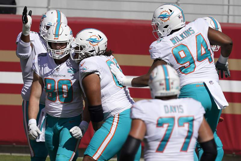Miami Dolphins wide receiver Adam Shasheen (80) is congratulated by teammates after scoring against the San Francisco 49ers during the first half of an NFL football game in Santa Clara, Calif., Sunday, Oct. 11, 2020. (AP Photo/Tony Avelar)