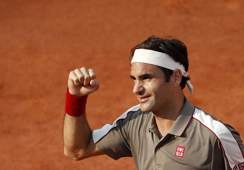 FILE - In this Tuesday, June 4, 2019 file photo, Switzerland's Roger Federer celebrates winning his quarterfinal match of the French Open tennis tournament against Switzerland's Stan Wawrinka in four sets, 7-6 (7-4), 4-6, 7-6 (7-5), 6-4, at the Roland Garros stadium in Paris. Roger Federer announced Sunday April 18, 2021, he will play at the French Open, and the Swiss star is preparing for it on home clay at a tournament in Geneva next month. (AP Photo/Jean-Francois Badias, File)
