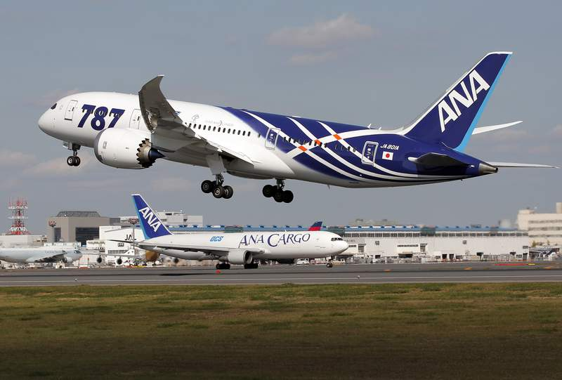 FILE - In this Wednesday, Oct. 26, 2011 file photo, All Nippon Airways Boeing 787 takes off for the airplane's inaugural commercial flight to Hong Kong at Narita International Airport in Narita, east of Tokyo.  Boeing has again halted deliveries of its 787 jetliner after federal regulators asked for more information about production flaws, including small gaps where panels of the fuselage are joined. A Boeing spokesman said Friday, May 28, 2021 that the company is working with the Federal Aviation Administration to provide more information about the company's analysis and documentation of work on new 787s. He said the delay affects near-term deliveries.(AP Photo/Itsuo Inouye, File)