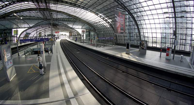 A person stands on an empty station platform at the main station in Berlin, Germany, Thursday, Sept. 2, 2021. A nationwide, five-day train strike has brought big parts of the German railway and commuter system to a standstill. (AP Photo/Michael Sohn)