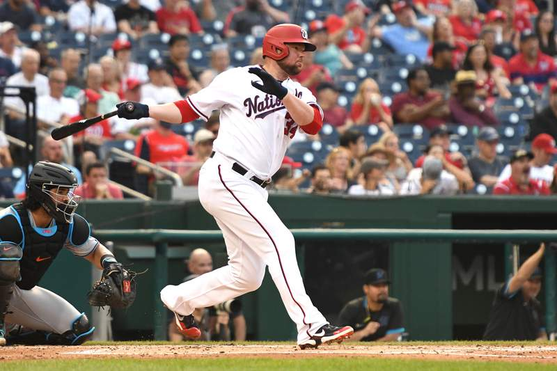 Jon Lester of the Washington Nationals hits a single in the second inning during a baseball game against the Miami Marlins at Nationals Park on July 19, 2021 in Washington, DC.