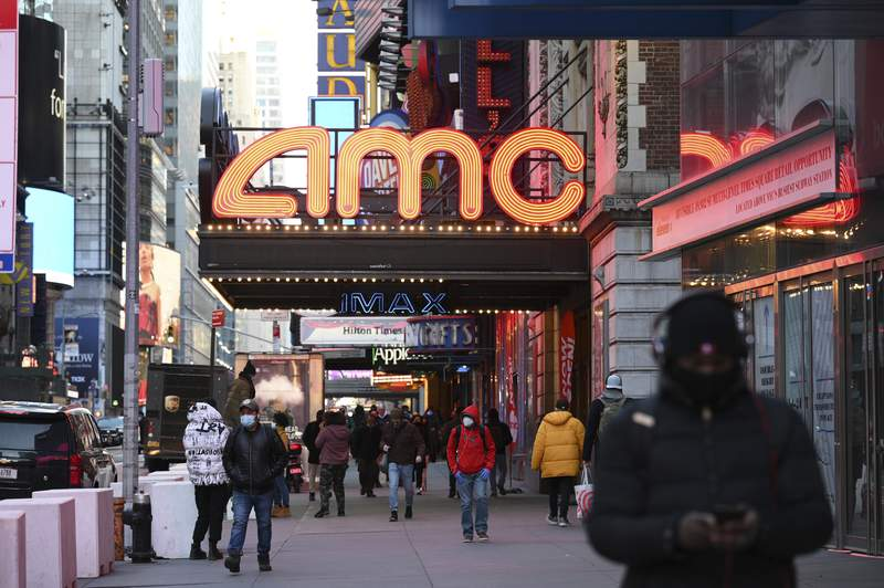 The AMC Empire 25 theater reopens after COVID-19 closures, Friday, March 5, 2021, in New York. Movie theater chain AMC is selling 8.5 million shares to investment firm Mudrick Capital Management, raising $230.5 million and cashing in on the meme stock frenzy that has helped boost its stock price in recent months. AMC Entertainment Holdings Inc. said Tuesday, June 1 that it will use most of the proceeds for acquisitions of additional theater leases and to invest in its existing theaters to make them more attractive to moviegoers.   (Photo by Evan Agostini/Invision/AP)