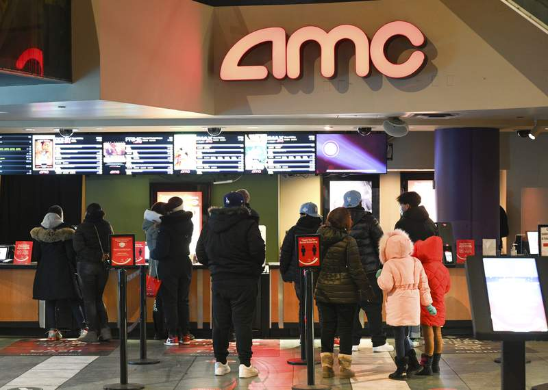 FILE - In this March 5, 2021 file photo, people line up for movie tickets at a reopened AMC theater in New York.  AMC said Wednesday, June 2,  that its launching AMC Investor Connect, an initiative that will put the company in direct communication with its individual shareholders to keep them up to date about important company information and provide them with special offers.   (Photo by Evan Agostini/Invision/AP, File)