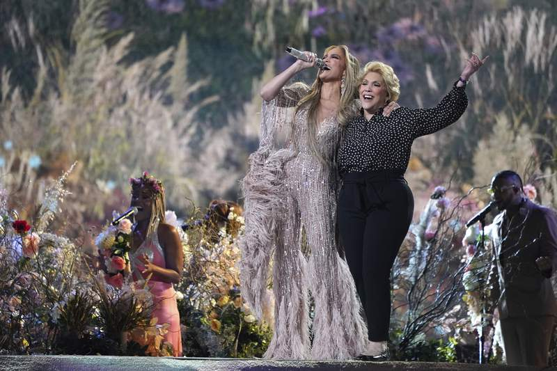 """Jennifer Lopez performs with her mother, Guadalupe Rodrguez, at """"Vax Live: The Concert to Reunite the World"""" on Sunday, May 2, 2021, at SoFi Stadium in Inglewood, Calif. (Photo by Jordan Strauss/Invision/AP)"""