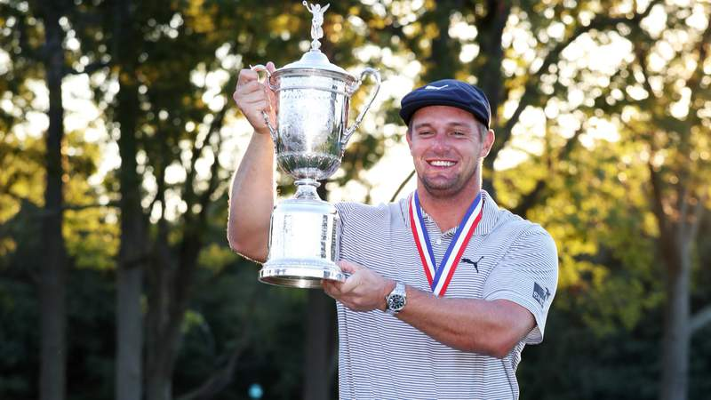 Bryson DeChambeau of the United States celebrates with the championship trophy after winning the 120th U.S. Open Championship on September 20, 2020 at Winged Foot Golf Club in Mamaroneck, New York. (Photo by Jamie Squire)
