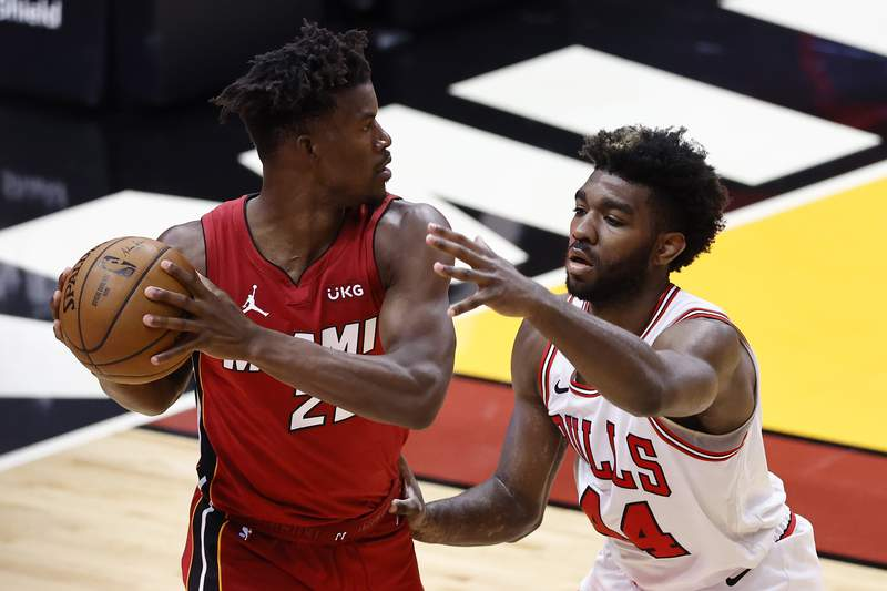 Patrick Williams of the Chicago Bulls defends Jimmy Butler of the Miami Heat during the third quarter at American Airlines Arena on April 24, 2021 in Miami, Florida.