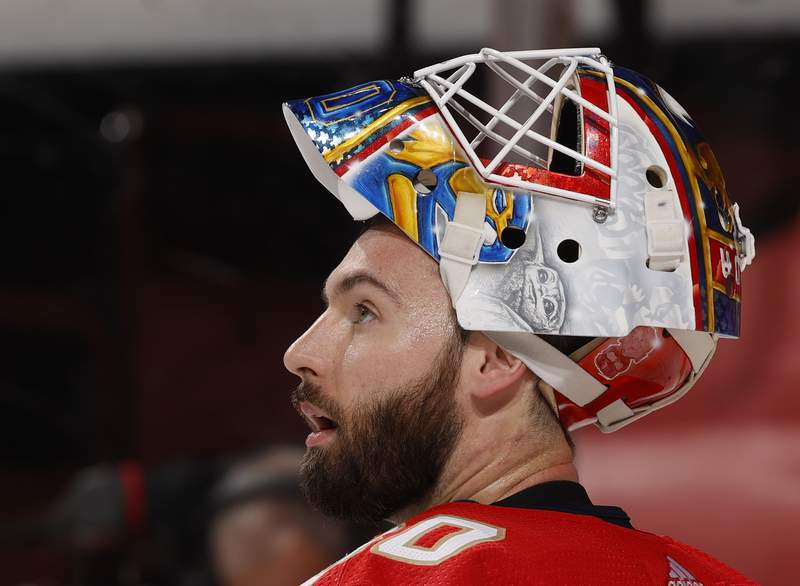 Goaltender Chris Driedger of the Florida Panthers watches a replay after making a save against the Dallas Stars at the BB&T Center on February 22, 2021 in Sunrise, Florida.