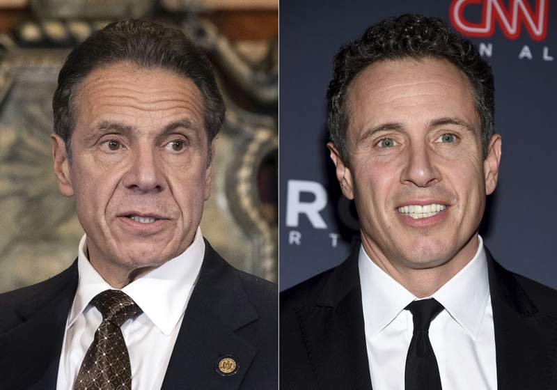 FILE -New York Gov. Andrew M. Cuomo appears during a news conference about the COVID-19at the State Capitol in Albany, N.Y., on Dec. 3, 2020, left, and CNN anchor Chris Cuomo attends the 12th annual CNN Heroes: An All-Star Tribute at the American Museum of Natural History in New York on Dec. 9, 2018. CNN said Thursday, May 20, 2021 it was inappropriate for anchor Chris Cuomo to have been involved in phone calls with the staff of his brother, New York Gov. Andrew Cuomo, where strategies on how the governor should respond to sexual harassment allegations were allegedly discussed.(Mike Groll/Office of Governor of Andrew M. Cuomo via AP, left, and Evan Agostini/Invision/AP)