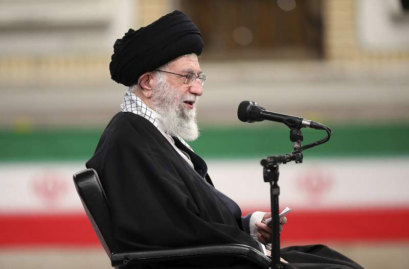 In this picture released by the official website of the office of the Iranian supreme leader, Supreme Leader Ayatollah Ali Khamenei speaks during a meeting with army's air force and air defense staff in Tehran, Iran, Sunday, Feb. 7, 2021. Iran's supreme leader said the U.S. must lift all sanctions if it wants Iran to return to its commitments to the nuclear deal with Western powers. (Office of the Iranian Supreme Leader via AP)