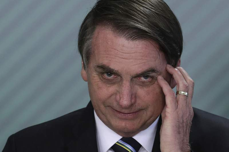 FILE - In this April 9, 2019 file photo, Brazil's President Jair Bolsonaro speaks during a swearing-in ceremony at the Planalto Presidential Palace, in Brasilia, Brazil. Bolsonaros latest education minister offered his resignation Tuesday, June 30, 2020, just days after his appointment, creating a new headache for the embattled leader as he struggles to start a new chapter at the ministry and shore up flagging support. (AP Photo/Eraldo Peres, File)
