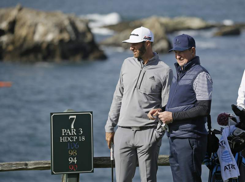 FILE - In this Saturday, Feb. 9, 2019, file photo, Dustin Johnson, left, and Wayne Gretzky stand on the seventh tee of the Pebble Beach Golf Links during the third round of the AT&T Pebble Beach Pro-Am golf tournament, in Pebble Beach, Calif. The Feb. 11-14 tournament will not have celebrities for the first time because of the COVID-19 pandemic. (AP Photo/Eric Risberg, File)