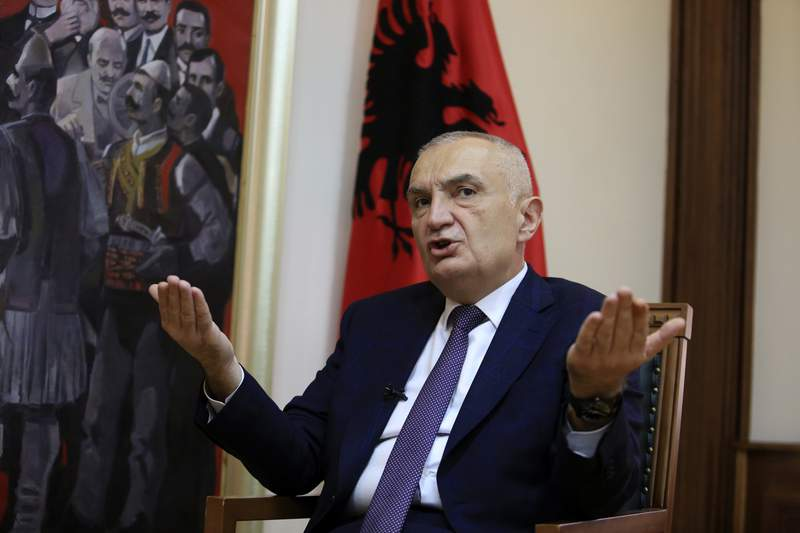 FILE - In this Wednesday, April 21, 2021 file photo, Albanian President Ilir Meta speaks during an interview with the Associated Press in Tirana, Albania.  Albanias president has accused the U.S. ambassador of intervening in the small European countrys internal affairs by supporting its prime minister in an upcoming parliamentary election. Meta spoke harshly about Ambassador Yuri Kim during a television talk show on Friday, April 23, 2021. While the show was airing, Kim sent a text message to Meta and also tweeted about Sundays election. (AP Photo/Hektor Pustina, File)