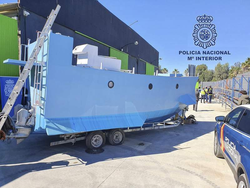 In this photo provided by the Spanish National police on Friday March 12, 2021, a homemade semi submersible submarine sits outside a warehouse in Malaga, Spain. Spanish police say they have seized a homemade narco-submarine able to carry up to 2 metric tons (2.2 tons) of cargo. Police came across the 9-meter-long (30-feet-long) craft being built in Mlaga, on southern Spains Costa del Sol, during a broader international drug operation. Police said Friday it has two 200-horsepower engines, which are operated from the inside. (Police Nacional via AP)