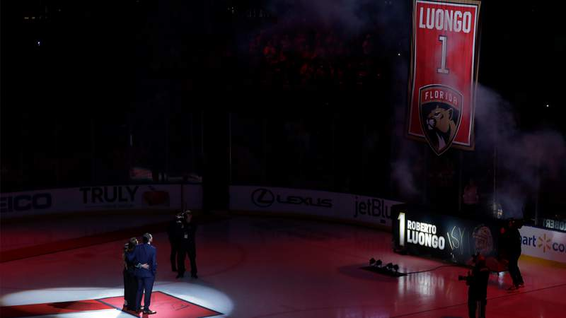 Former Florida Panthers goalie Roberto Luongo, left, and his family watch as his jersey is hoisted to the BB&T Center rafters on Saturday, March 7, 2020.