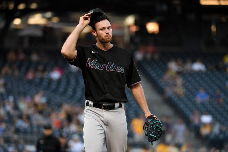 Anthony Bender of the Miami Marlins reacts as he walks off the field after giving up 4 runs in the eighth inning during the game against the Pittsburgh Pirates at PNC Park on June 5, 2021 in Pittsburgh, Pennsylvania.